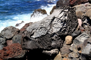 Everything on this island is volcanic in origin.  Walking along the north-facing shoreline was characterised by rough seas and a huge variety of bits of lava bubble and other volcanic boulders.