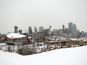 Looking across the Saddledome to Downtown high rise