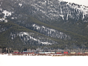 Train line on the opposite said of one of the Vermillion Lakes