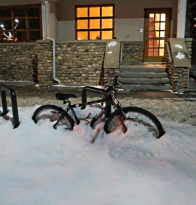 Bicycles half buried in snow are scattered around the town for weeks on end