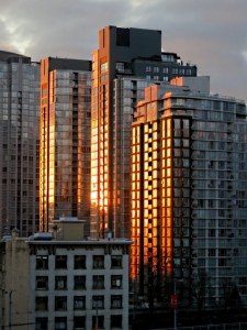 Tower blocks blazing gold in the early morning sun