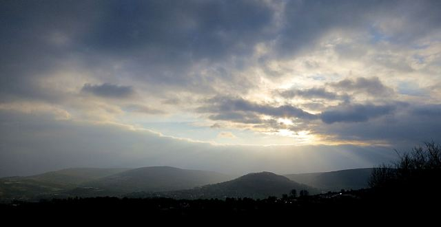 The occasional gap in the clouds gives an ethereal light to ridges of the South Wales Coalfield