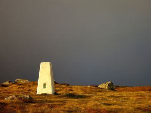 17.22, reaching the trig point on the top with snow clouds to the north