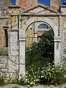 Built in the 19th Century, derelict since damage in WW2, today brightened by floral threshold