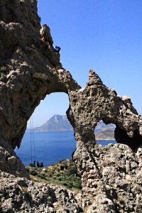 Looking through an 'eye' in the rock along the channel between Telendos Island and Kalymnos