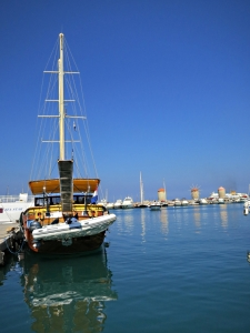 Reflecting in Mandraki Harbour