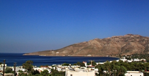 Looking across the bay from teh Upper Terrace of my apartment.  The 'Faros' is the furthest building at sea level