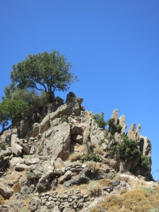 Lava pinnacles reinforced by stone walls, the approach to the ancient fortress of Parletia