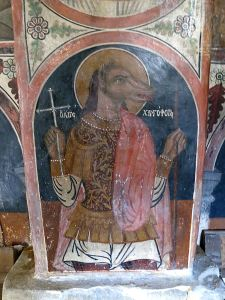 The old churches in Mikro Horio are decorated with old frescos, this one of St Christopher reflects the view that he was from a poeple with the head of a dog.