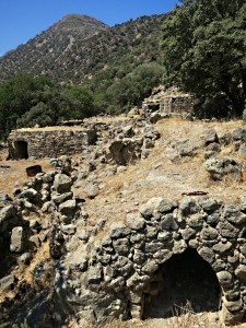 A cluster of ancient houses underneath the agricultural terraces
