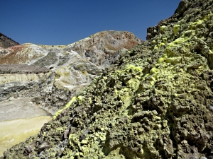 Clusters of sulphur-encrusted fumaroles line the rocky sides of Polyvotis