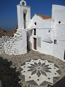 The Hochlakos patterned courtyard and the spiral stone steps to the bell tower