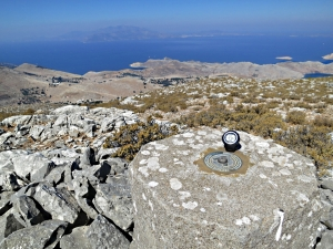 The trig point on the summit looking beyond Europe to Asia Minot
