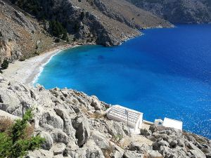 Looking down to the tiny cliff-edge monastery of Agios Vasilios with Lapathos Beach below