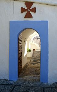 The iron-studded oak door to the inner courtyard stands open, key in the lock