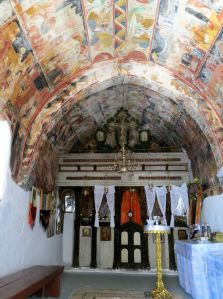 The fresco covered walls and ceilings inside the chapel
