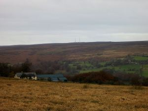 Looking across the sepia-coloured grass on the high acid moorland, the Foxhunter masts just visible, the path zigzagging off to the left and then back right to avoid the valley