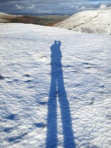 Tall photographer on the summit, extra tall because only 5 days after the Winter Solstice