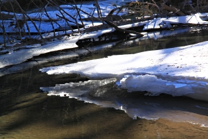 Zooming in on snow-covered ice which collapsed in the thaw as water levels dropped