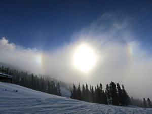 Partial 'icebow' refracted through a band of cloud