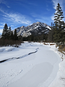 Looking up the now frozen creek towards Mount Norquay