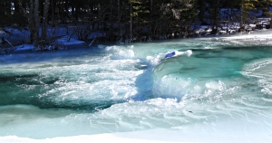 Thick ice forms over the rocks on the rapids