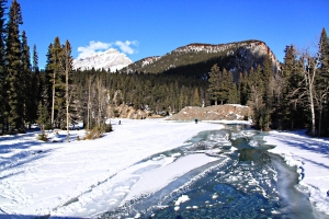 Looking down the Spray towards its confluence with the Bow, Tunnel Mountain behind