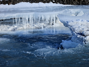 Water level drops as the ice sheet breaks up