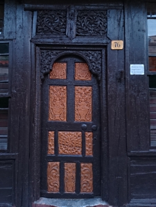 Carved wooded door of a 'traditional' kafenion