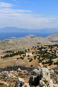 Looking down from the path  to the Roukouniotis monastery and Turkey beyond