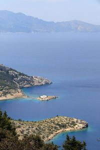 Looking over the island monastery of Agios Emilianos to the Turkish coast beyond