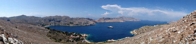 The panorama along the Pedi Bay with thunder clouds over Turkey beyond
