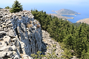 Castle walls on top of the crag, Agios Emilianos island monastery in the distance