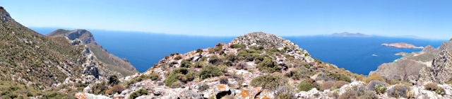 Wide panoramic view from the slabs in the col. Nisyros in the background