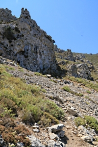 .... and leads across a scree below cliffs
