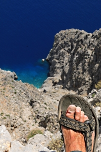 Photographer on the edge:  500 metres straight down to cool blue sea
