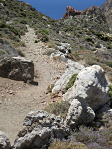 The path to Tholos from the col passes through a threshing circle