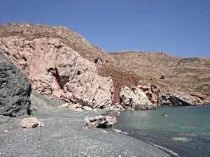 .... and looking back along the beach of 'Green Tholos' to the cliff and its fissure
