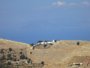 Looking across the the ridge-top monastery of Panagia Mirtiotissa far below