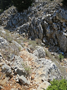 Dropping down sloping slab into the top of the gorge to cross to the other side