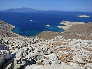 Looking down across the boulder-field to the short spur of a peninsula far below, Turkey across the water