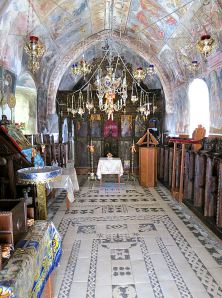 The magnificent inside of the church with hochlakos floor and walls and ceiling covered in frescos