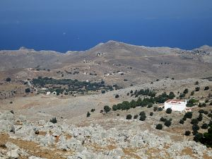 Looking across the mid-level plateau and the fortress-like Roukouniotis monastery