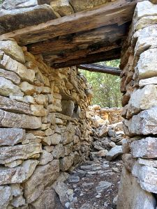 Thick stone walls and stout wooden lintels