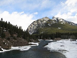 From the crag above Bow Falls looking downstream to the confluence with The Spray Rive, Mount Rundle bahind