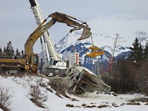 Derailed and split wagon with large-scale equipment above