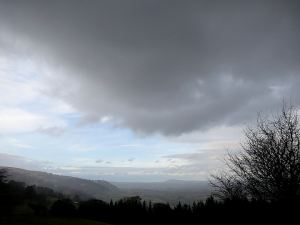 Narrow blue slot being overtaken by rain cloud