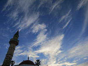 Minaret on old mosque in the agora points to high cirrus cloud