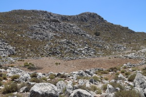 From the lower edge of the enclosure looking down to the flat area at the lowest point of the valley, an area cleared of stones and which floods and collects sediment
