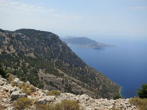 View from the compound of Stavros Polemou with Megalos Sotoris further along the cliffs and Panormitis with its large bay in the distance